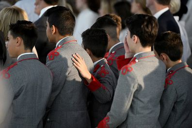 Students from The King's School are seen comforting eating other during the funeral for their friend Anthony.