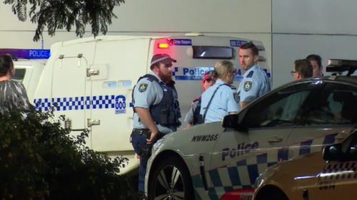 A police officer and a security guard were shot in the struggle. (9NEWS)