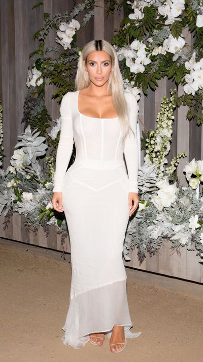 "Kim Kardashian West has debuted a fresh  take on her favourite tightly-wound garment- the corset.<br /> <br /> At the Los Angeles launch of her <a href=""https://style.nine.com.au/2017/11/09/08/56/kim-kardashian-perfume-fragrance-kkw-beauty"" target=""_blank"" draggable=""false"">KKW fragrance</a> the reality star showed how to work the waist-accentuating trend without looking like a Victorian throwback. <br /> <br /> Instead of opting for an on-trend corset-style belt, Mrs West stepped out in a simple, white dress from Dolce &amp; Gabbana with a built-in bustier that hugged her curves in all the right places.<br /> <br /> While Kim&rsquo;s vampy look may not be exactly budget-friendly, thankfully, corsets come in all shapes, sizes and prices. <br /> <br /> The trick is not to think of the corset as an outdated lingerie staple, but rather as a fetish-forward way to enliven dull daywear. <br /> <br /> Dip your toe into this coveted trend with some of our favourite corset pieces. Click through to find one that is right for you."