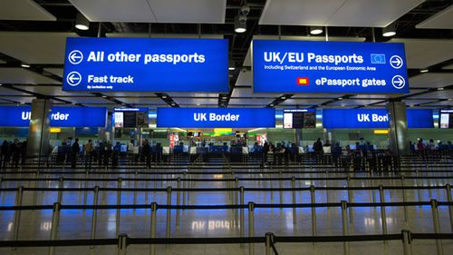 Passengers pass through border controls at Terminal 2, The Queen Terminal, at Heathrow Airport, London.