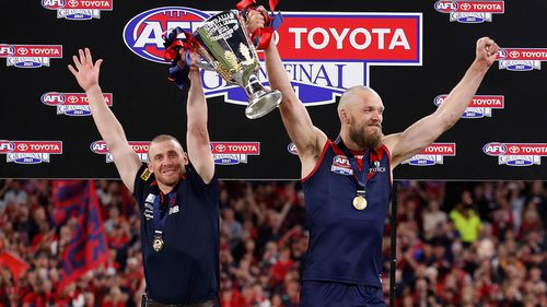 Simon Goodwin, Senior Coach of the Demons and Max Gawn of the Demons hold the cup aloft during the 2021 Toyota AFL Grand Final match between the Melbourne Demons and the Western Bulldogs at Optus Stadium on September 25, 2021 in Perth, Australia. (Photo by Michael Willson/AFL Photos via Getty Images)