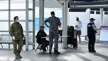 Passengers arrive at Sydney International Airport from Los Angeles off the United Airlines flight UA839 that arrived just after 6am on October 1.