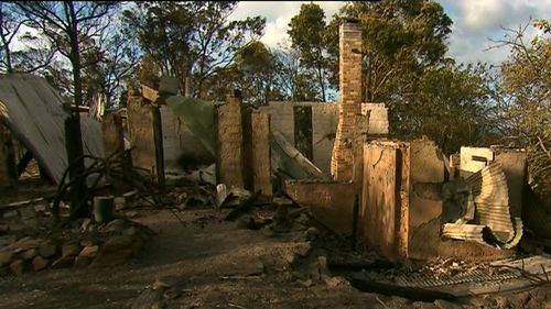 Locals have been allowed to return to the town after the fire was downgraded. (9NEWS)