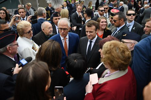 President Macron with Prime Minister Malcolm Turnbull after the event. Picture: AAP