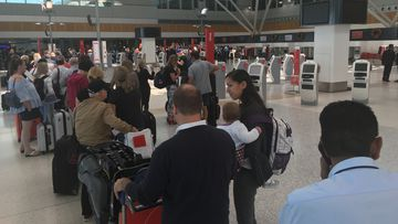 Travellers are facing queues of up to 200 metres long. (Image: Max Roberts)