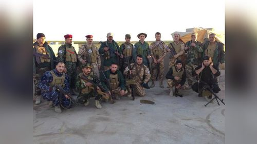 Mr Khamis with fighters in Iraq. (Supplied)