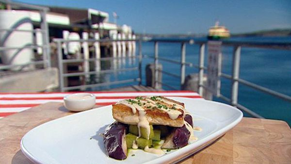 Char-grilled swordfish with steamed marinated egg plant, pesto potatoes and truffle dressing