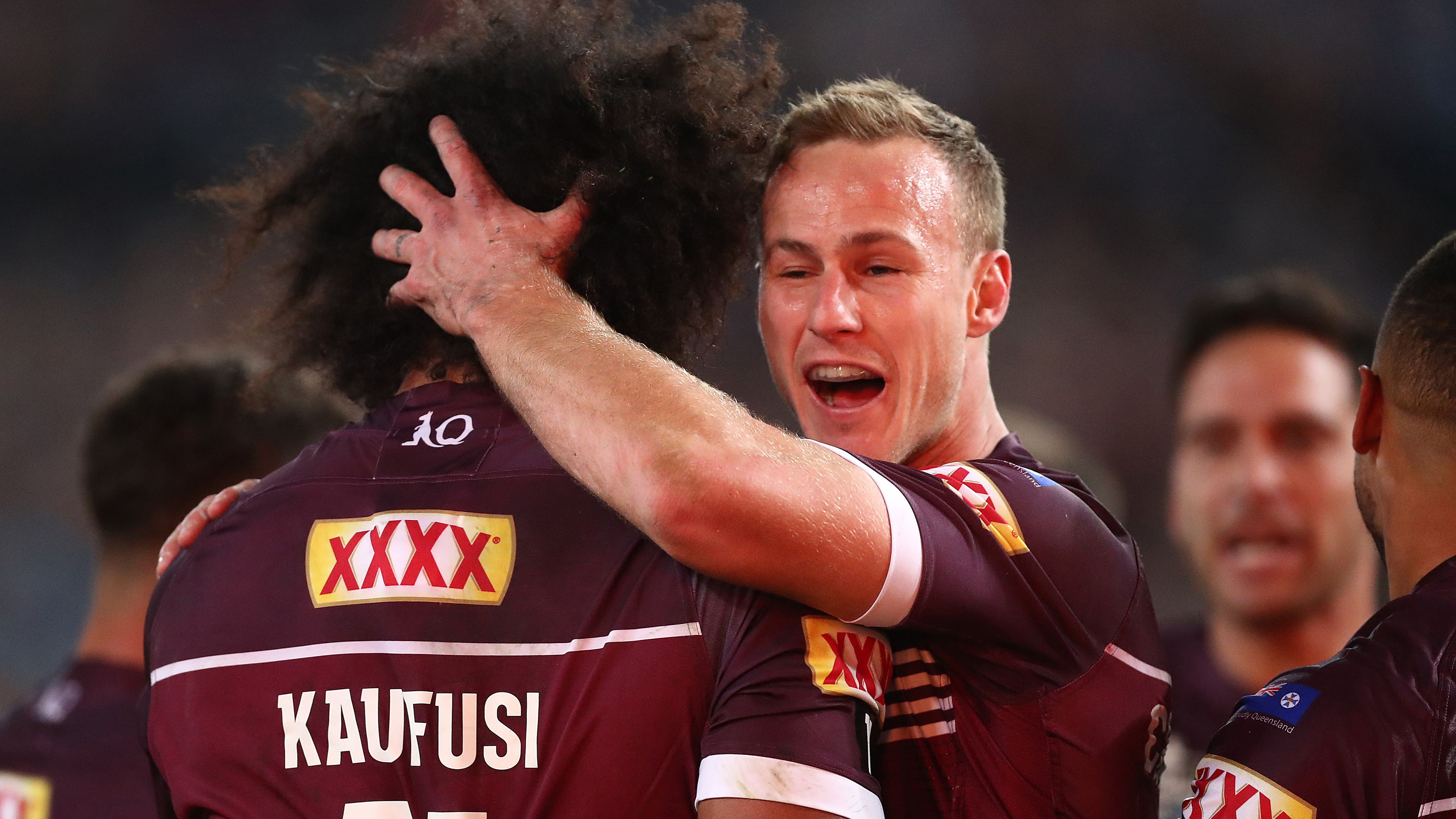 Felise Kaufusi is embraced by Queensland captain Daly Cherry-Evans.