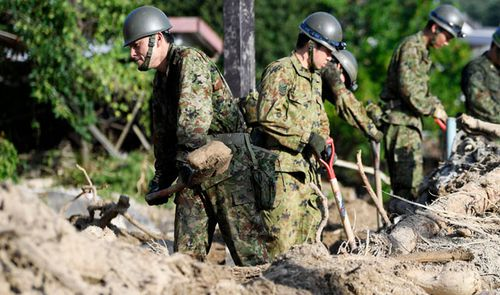 The Japanese military have been called in to the disaster areas. (AP).