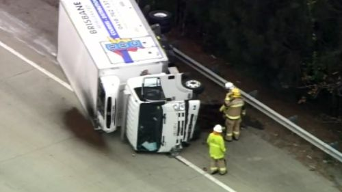 A truck and police car crashed on the Pacific Motorway. (9NEWS)