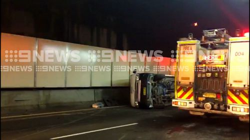 A ute was tipped on the Eastern Distributor, spilling concrete onto the road. (9NEWS)