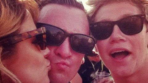 Is Harry cool with this? Caroline Flack parties with One Direction's Niall
