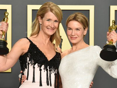 """Laura Dern, winner of the award for best performance by an actress in a supporting role for """"Marriage Story"""", left, and Renee Zellweger, winner of the award for best performance by an actress in a leading role for """"Judy"""", pose in the press room at the Oscars on Sunday, Feb. 9, 2020, at the Dolby Theatre in Los Angeles"""