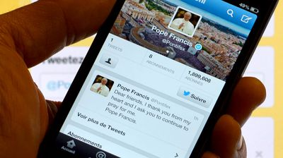 Smartphone showing Pope Francis' first tweet in March 2013 (GABRIEL BOUYS/AFP/Getty Images)