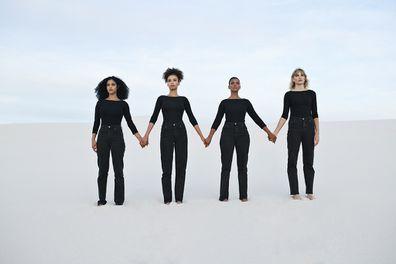 Women dressed in black holding hands