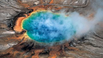 This undated photo provided by Robert B. Smith shows the Grand Prismatic hot spring in Yellowstone National Park's that is among the park's myriad hydrothermal features created by the fact that Yellowstone is a supervolcano, the largest type of volcano on Earth. (Robert B Smith via AP)