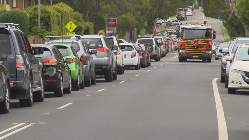 Large queues are forming at road border checkpoints as interstate travellers make their way out of NSW.