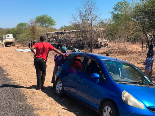 """The Red Cross said its teams responded to a """"horrific accident"""" involving a bus heading to neighboring South Africa at around midnight."""