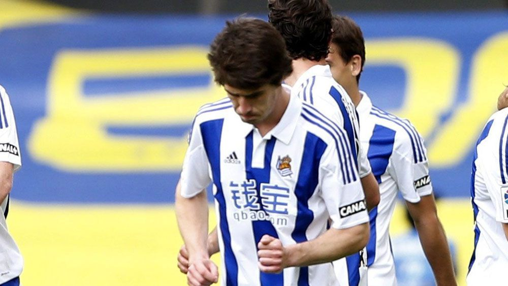 Real Sociedad players celebrate a goal during the match under investigation. (AAP)