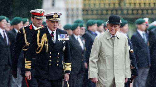 Britain's Prince Philip, Duke of Edinburgh, in his role as Captain General, Royal Marines, attends a Parade to mark the finale of the 1664 Global Challenge on the Buckingham Palace Forecourt in central London on August 2, 2017. (AFP)