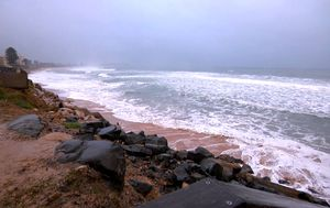 NSW coast lashed by night of wild weather and massive surf