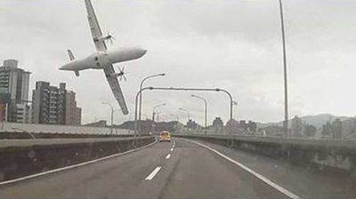 "<p _tmplitem=""5"">A driver in Taipei unwittingly captured the dramatic plane crash of a TransAsia Airways flight.</p><p _tmplitem=""5""> Footage of the incident filmed on the motorist's dashcam shows flight GE235 flying over a busy highway in New Taipei City, banking sharply and clipping a moving taxi before disappearing over the railing. </p><p _tmplitem=""5""></p>"