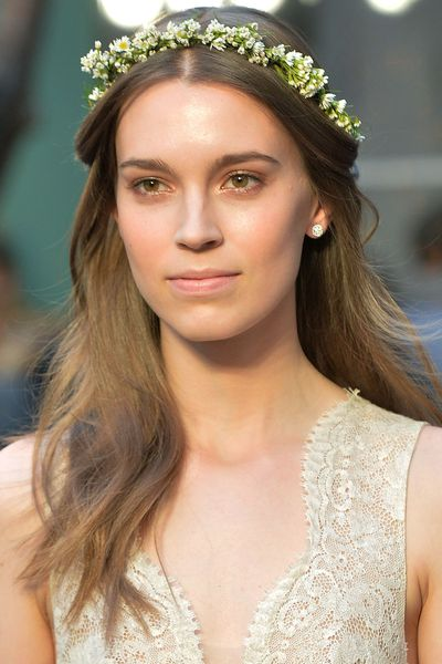 A delicate flower crown was placed over models' waves at Monique Lhullier.