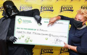 Jamaica's newest millionaire dresses as Darth Vader to receive mega jackpot prize