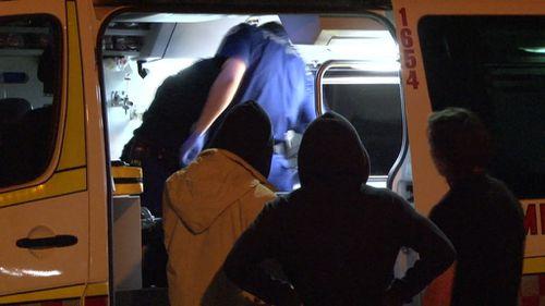 Paramedics treat the teen. (9NEWS)