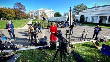 'It's on': Nine US Correspondent Adams checks her notes as she prepares for the camera to roll.