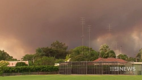 The fire looms over Harvey. (9NEWS)