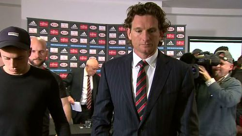 Hird leaving the Tullamarine media conference where he confirmed his resignation as coach. (9NEWS)