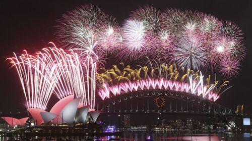 Fireworks light up the sky above Sydney Harbour. (AAP)