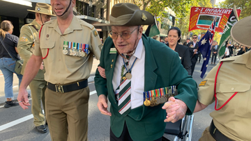 WWII vet joins Sydney march at 104