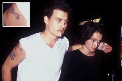 "Johnny made the most of his ""Winona Forever"" tattoo when the couple broke off their engagement in 1993. He got it changed to ""Wino Forever""!<br><br>Image: Getty"