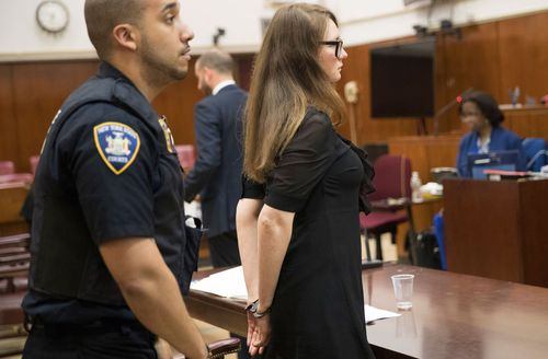 Court officers escort Anna Sorokin from the courtroom,