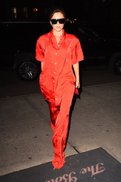 Designer Victoria Beckham loves a punchy red. Here she wears her own label.