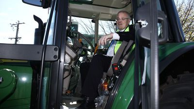 Scott Morrison gets behind the wheel of a tractor in Wangaratta.
