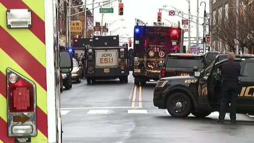 Two suspects have been shot by police after an armed hold up at a Jewish convenience store in New Jersey.