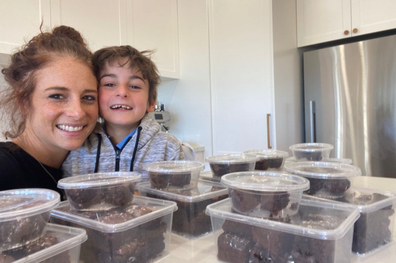 Nine-year-old Ariel Sher and his Mum, Vanessa in their kitchen with his baked goods.