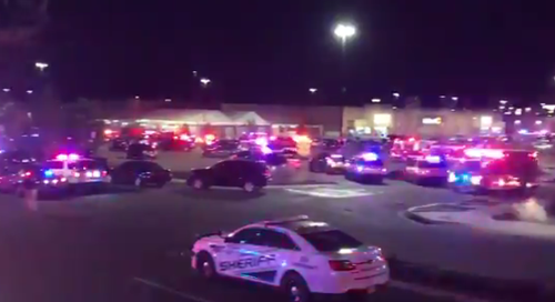 Dozens of police cars converged on the Walmart. (Twitter)