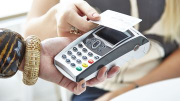 Tap and gone: Aussies struggling to save as cashless payments rise