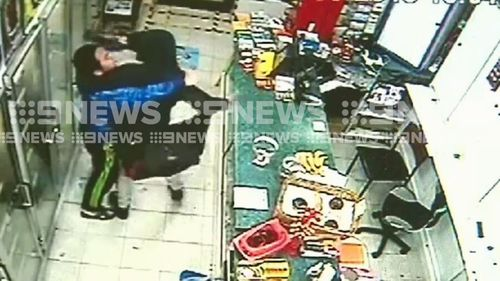 The fight breaks out between the shop attendant the thug.