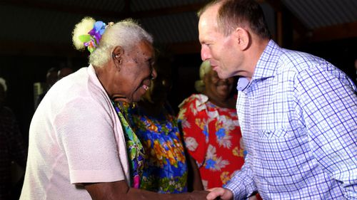 Prime Minister Tony Abbott is greeted by Kaurareg elder Ipiligal Alice Tom as he arrives on Horn Island in the Torres Strait. (AAP)