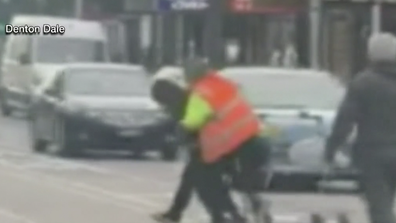 Video of the arrest shows Mr Dale apprehend the suspect in a Hi-Vis vest.