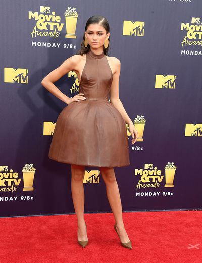 Zendaya arrives at the 2018 MTV Movie And TV Awards at Barker Hangar on June 16, 2018 in Santa Monica, California.