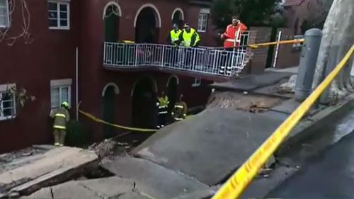 The sudden deluge caused a nearby brick wall to crumble, and local residents had to be evacuated. (9NEWS)