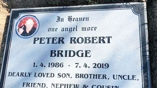 The headstone, with the photo of Peter Bridge sticking up his middle finger, which was removed.