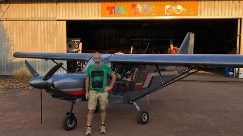 John Gotts with his plane.