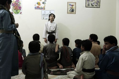 Boys recite poems during a session at a rehabilitation center for former child soldiers in Marib, Yemen.